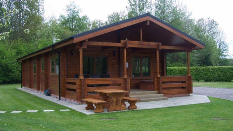 Dark wood log cabin